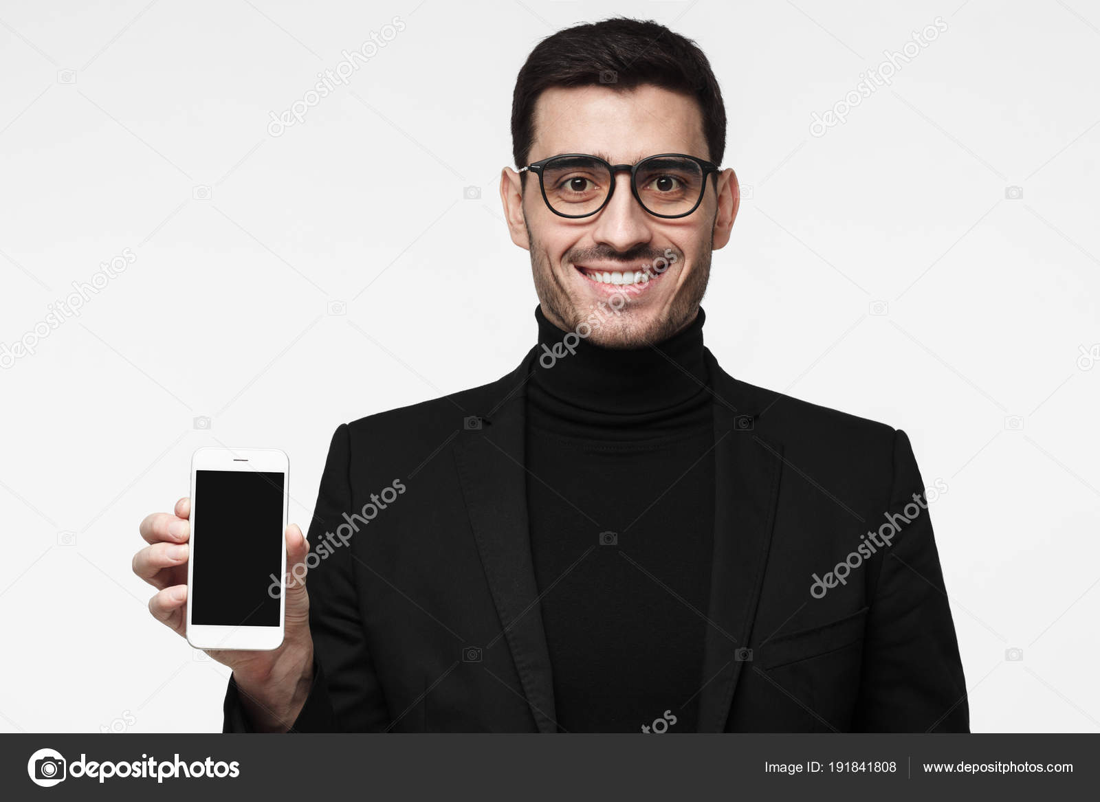 Handsome sophisticated business man isolated on grey background