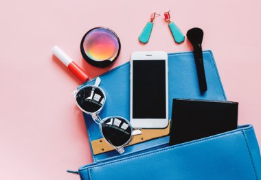 Woman bag with cosmetics and smartphone