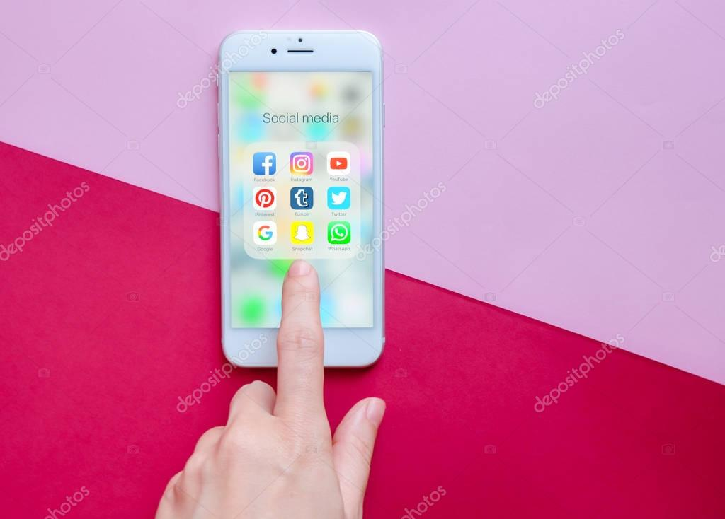 Hand touching Apple iPhone 6s