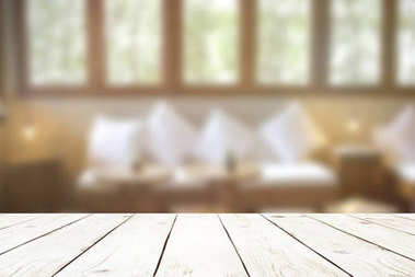 Empty wood table top on blur abstract of interior in cafe or living room, for montage product display