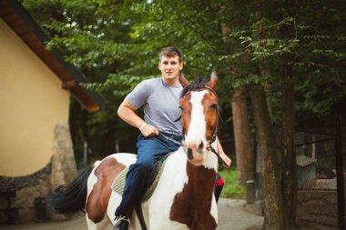 happy man riding horse