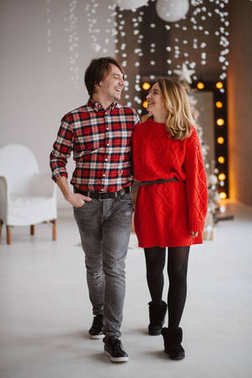 happy couple   enjoy each other  in the Christmas loft studio