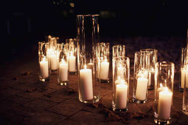 Many candles in glass vases on the floor on hipster style wedding stock vector