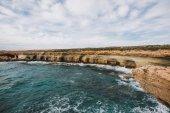 Fotografie sandy beach coast in the mediterranean sea landscape on Cyprus island