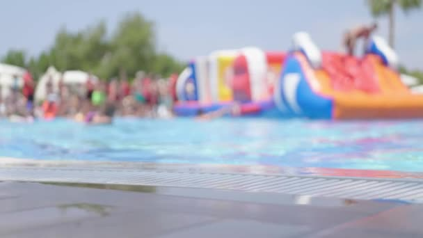 Aquapark slide with pool. Relaxation and sunbathing area.