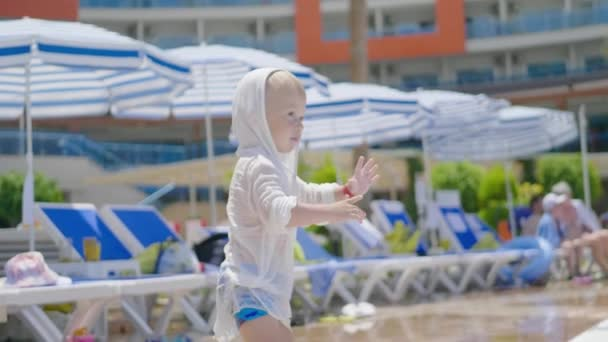 The funny little boy in summer at the beach on vacations.
