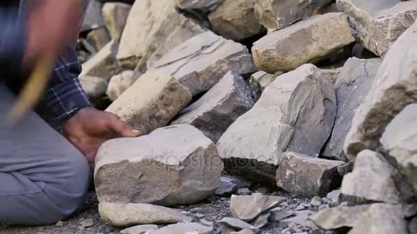 Stonemason cutting a block of granite with sledgehammer  Pitching stones  for construction  Stone worker with Sledge hammer hitting concrete block   Azerbaijan Sculptor Carving Stone  Stonemason carving
