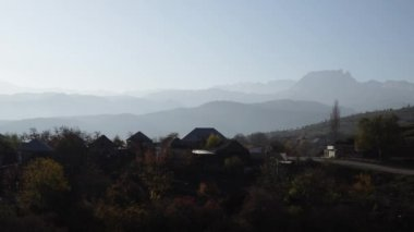 Caucasian mountains. The village is under the mountains. The Great Caucasus Range