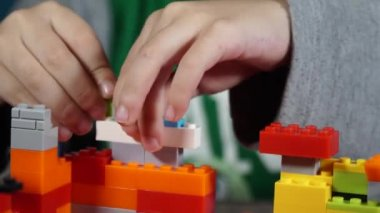 Little boy playing with constructor