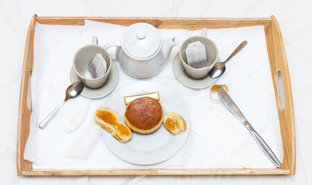 Romantic breakfast tray with fragrant tea fresh baking and jam on white background