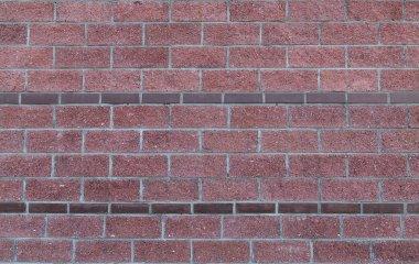 Brick red background with borders of narrow rectangular stone border symmetrical texture