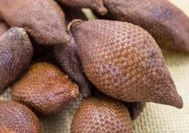 sweet tropical fruits of palm greens, snake fruit with brown peel