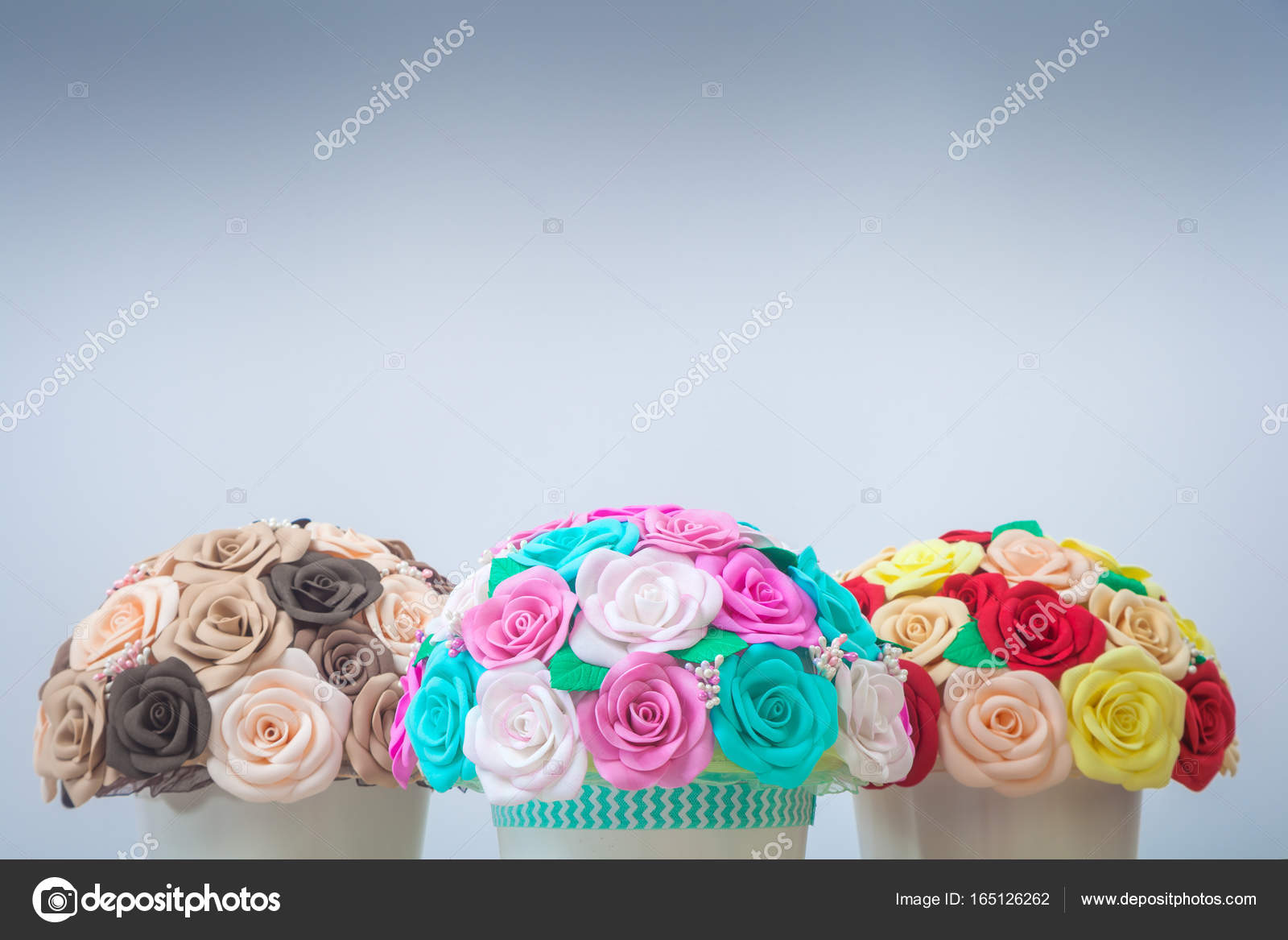 Artificial flowers roses from foam stock photo everyonensk artificial flowers roses from foam pink blue and white red yellow brown collected in a bouquet in three white pots stand on a light wooden table for mightylinksfo