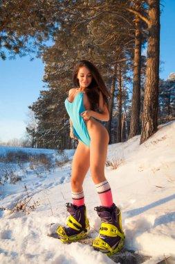 woman  in swimsuit on snowboard