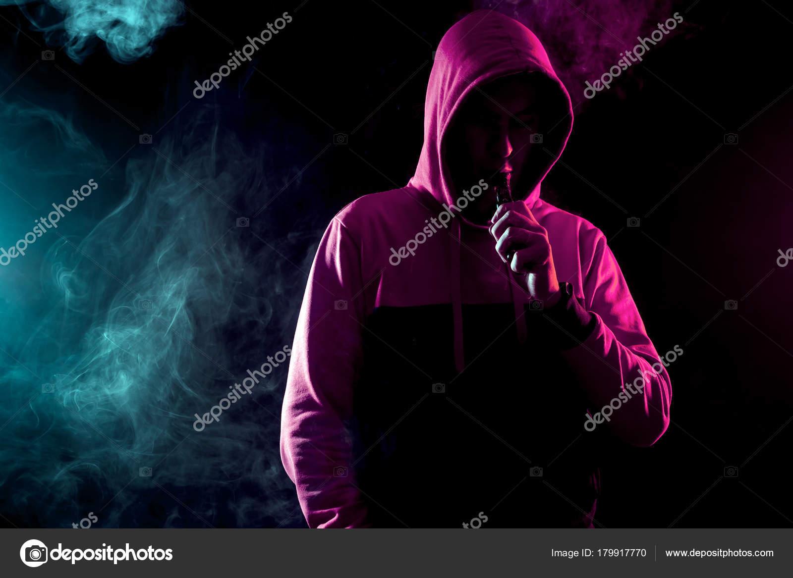 Man Smoke Vape Bright Light Background Green Pink Clouds