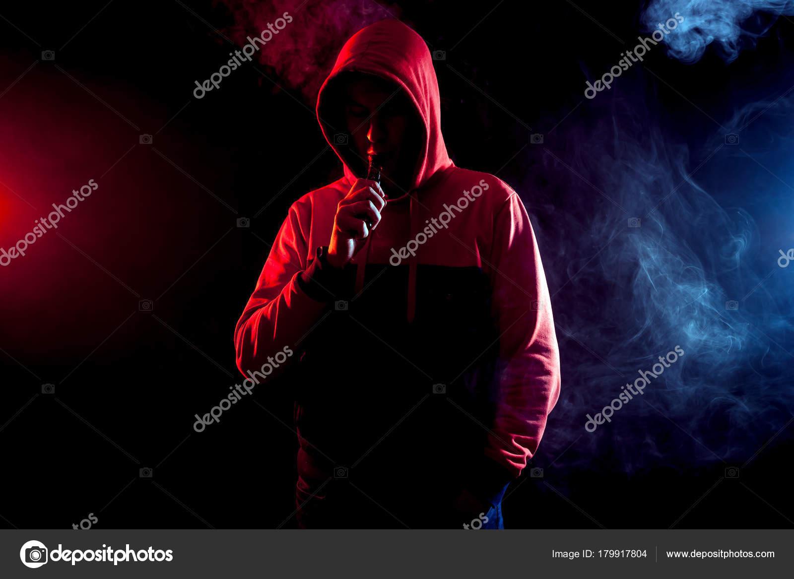Man Smoke Vape Bright Light Background Blue Red Clouds Smoke