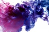 Dense multicolored smoke of blue and purple colors on a white isolated background. Background of smoke vape