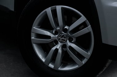 Novosibirsk, Russia  September 29, 2019:  Wolkswagen Tiguan , close-up car wheel with aluminum alloy wheel and new tire stock vector