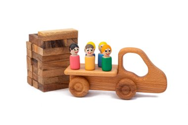 A wooden toy truck brought builders to the construction site. Images of builders from children's toys. Construction and construction site concept stock vector