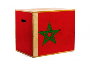 A wooden box for reliable shipment of various goods and cargo with the national flag of Morocco on a white isolated background. The concept of export-import and national delivery of goods.