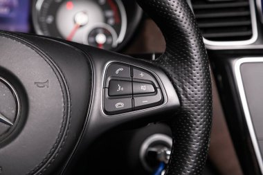 Novosibirsk/ Russia  April 02, 2020  Mercedes-Benz GLS-class, Car controller on steerling wheel ,Music,Control System Function and voice telephone in car. modern car interior