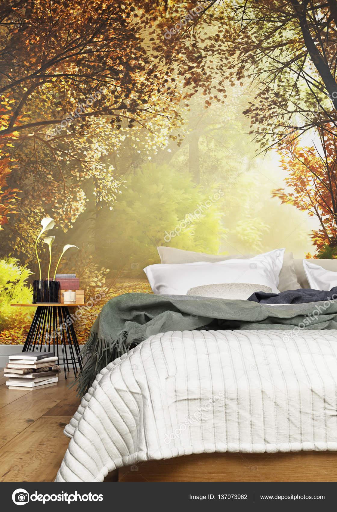 interieur van een gezellige rustieke slaapkamer met een land natuur muur muurschildering achtergrond stockfoto