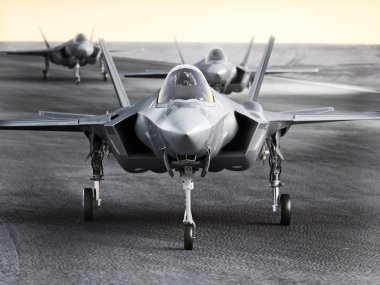 Multiple F35 military jet strike aircraft preparing for takeoff on a strike mission.