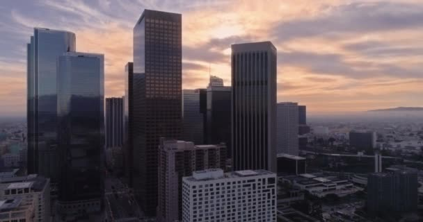 City skyline at Sunset. Aerial fly away of Los Angeles
