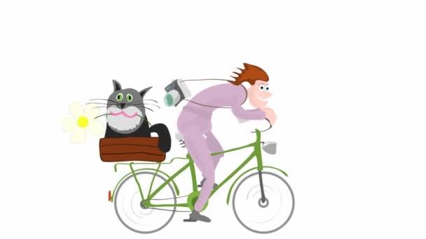 Ein Mann mit Kamera fährt ein Fahrrad mit einer Katze auf dem Kofferraum. Radfahren am Wochenende