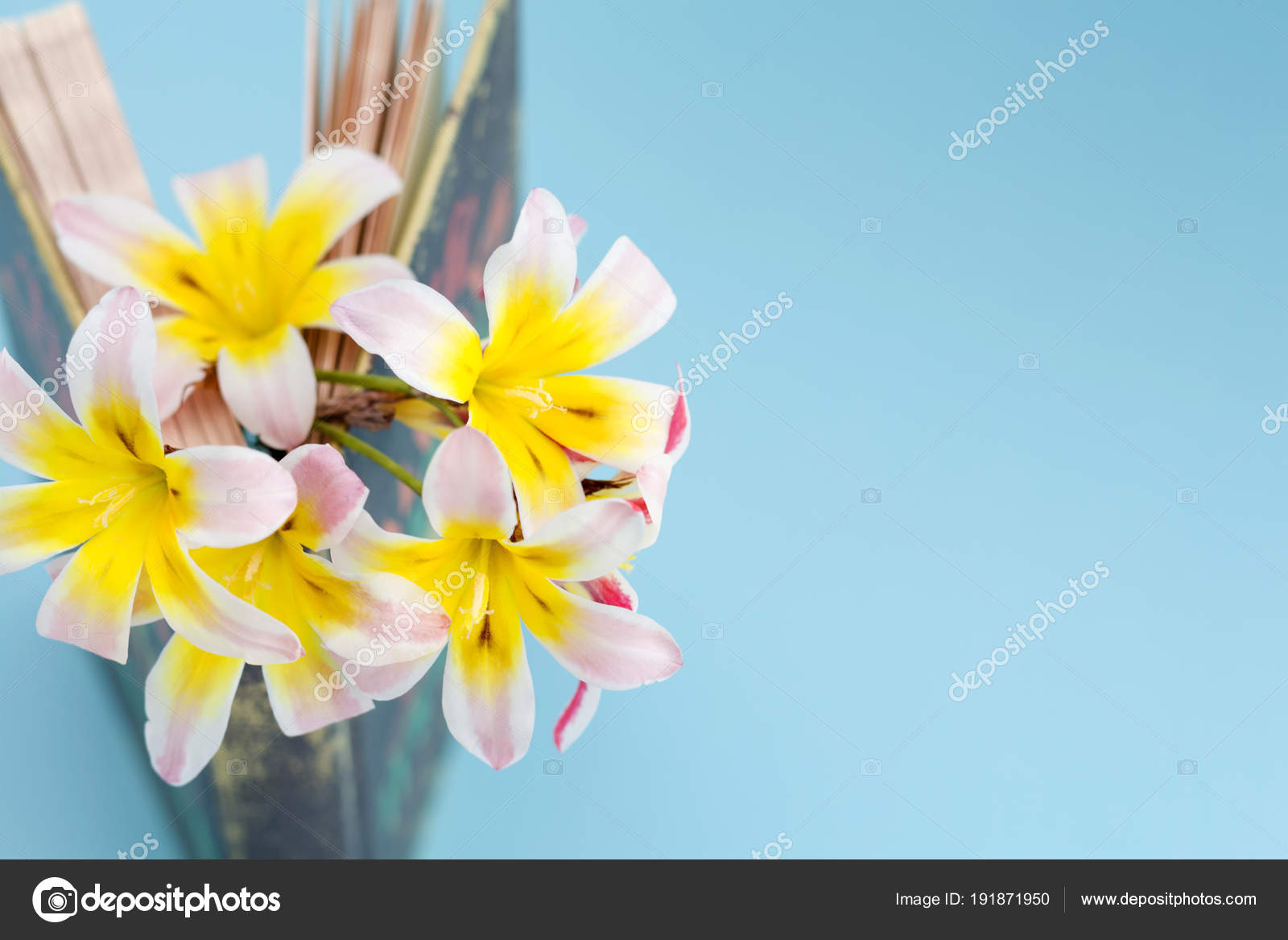 Colorful Spring Flowers Inbetween Pages Of Standing And Slightly