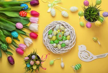 Easter eggs with colorful tulips on wooden background.Easter holiday concept. Easter decor.
