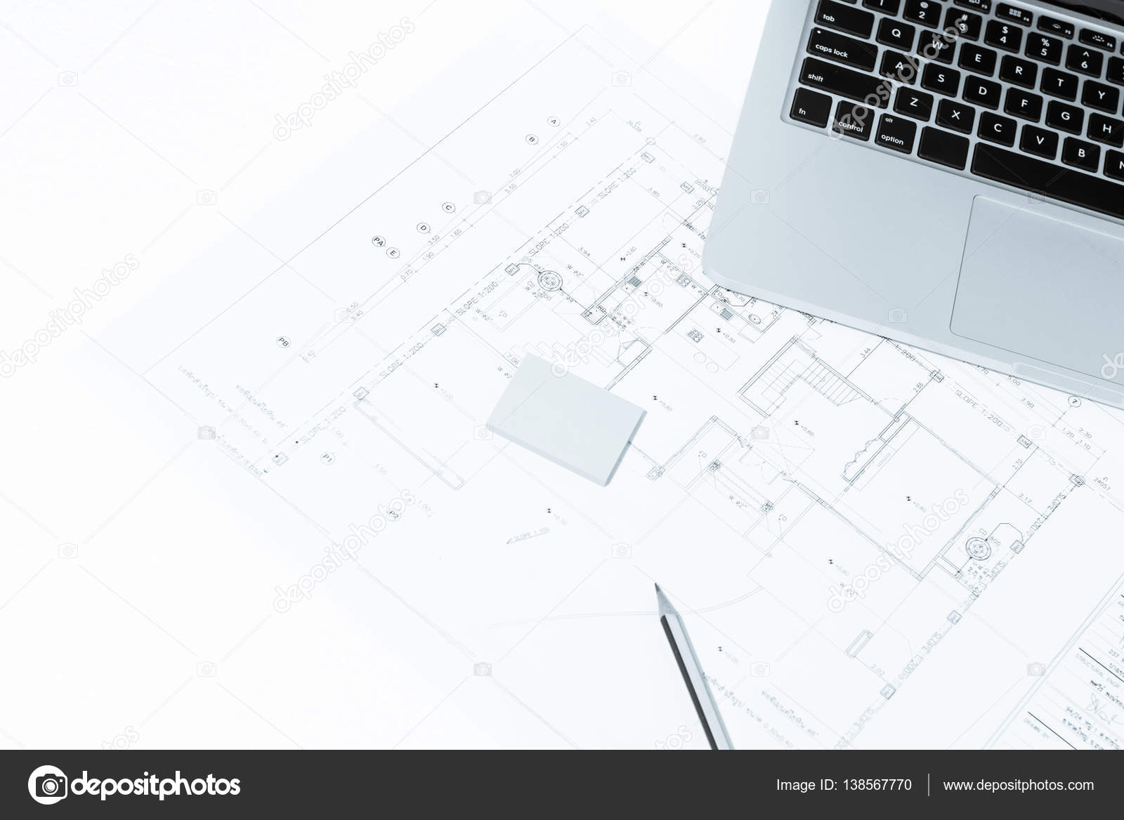 Pen and notebook over house construction blueprint with blue to pen and notebook over house construction blueprint with blue to stock photo malvernweather Choice Image