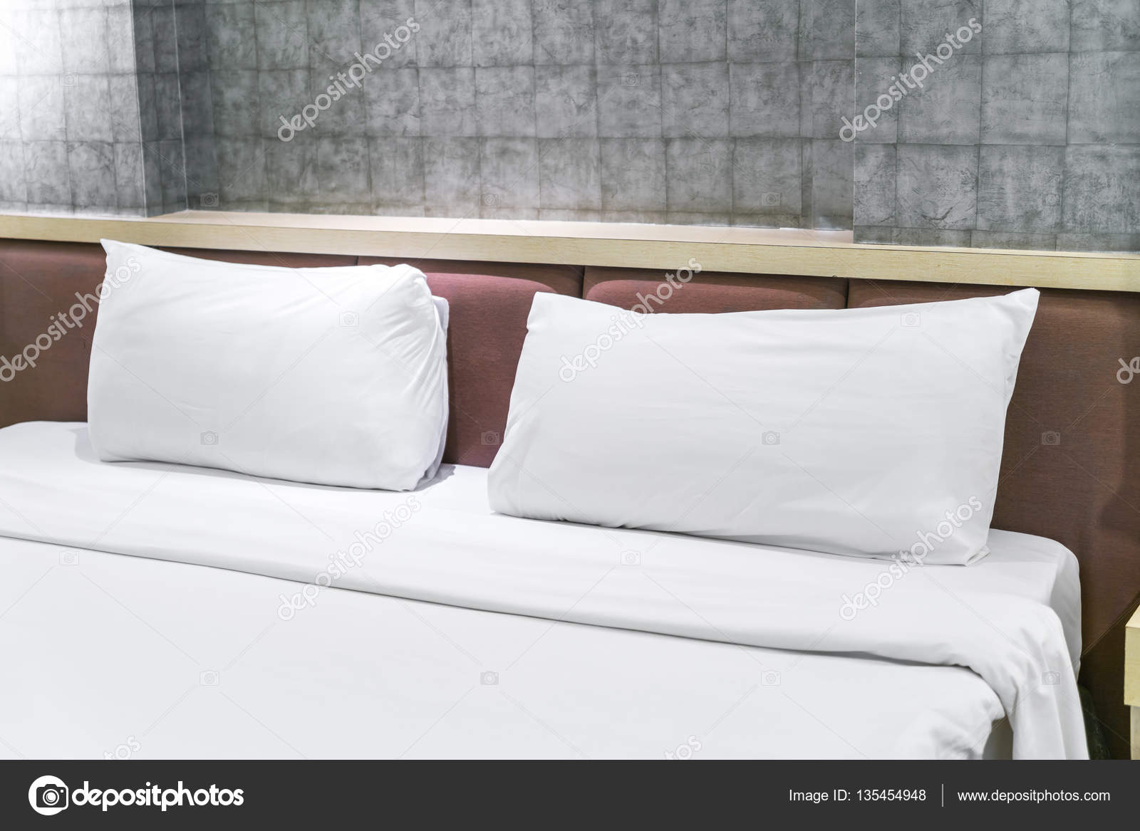 comfortable pillows and bed stock photo