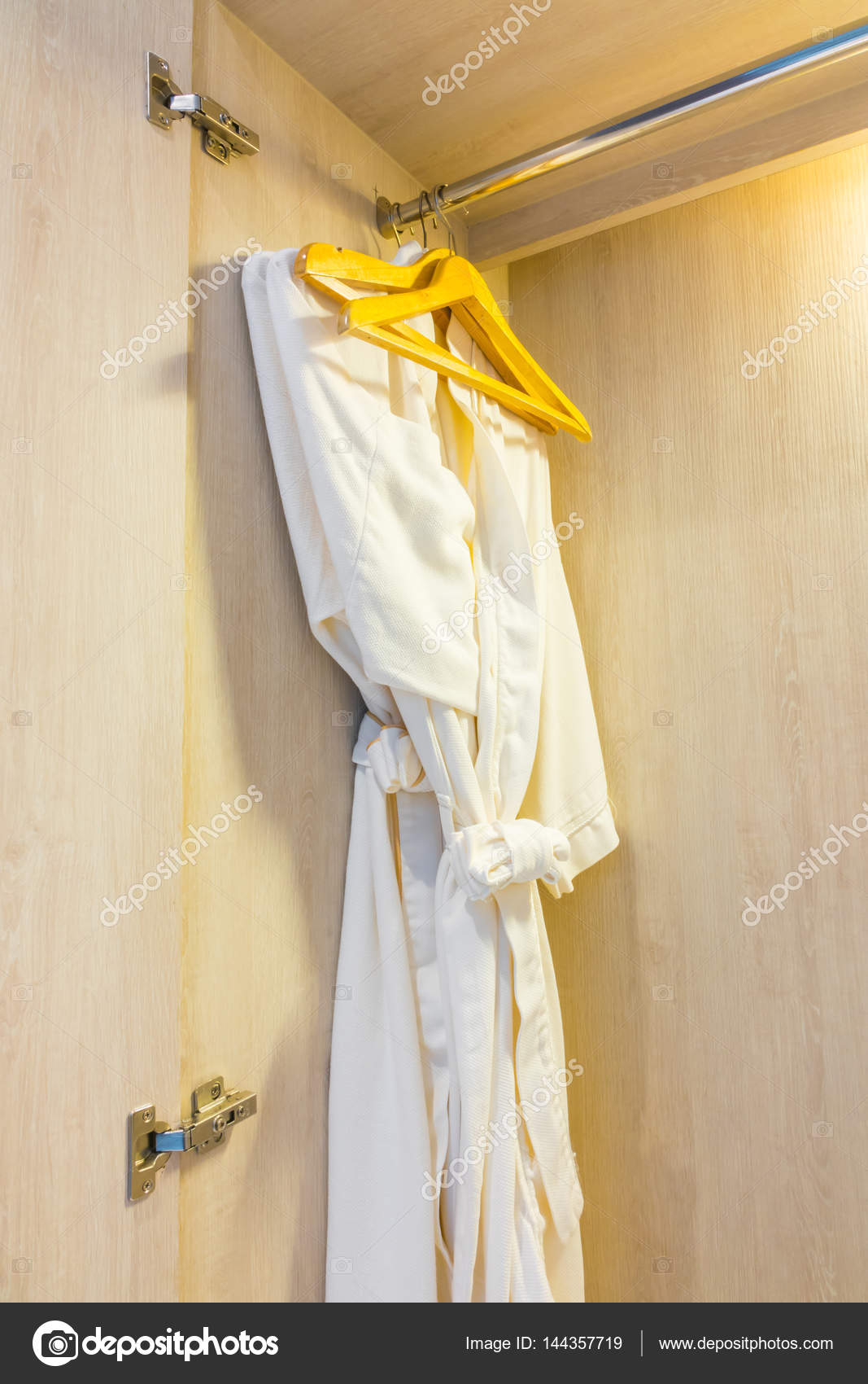 White Bathrobe In Wooden Wardrobe Of Luxury Hotel Stock