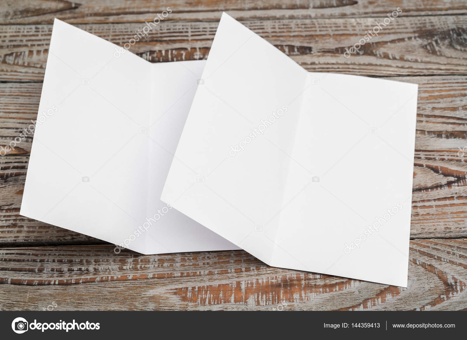 bifold white template paper on wood texture stock photo