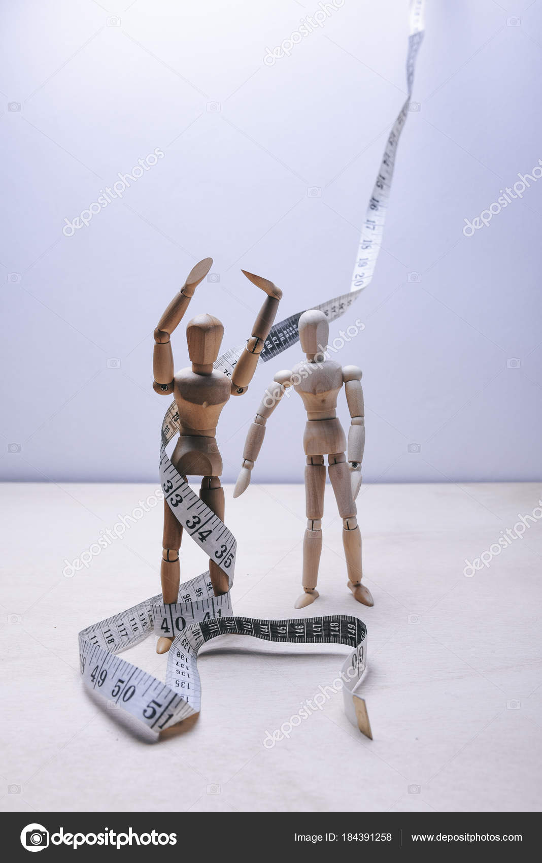 Wooden mannequins tape measure light background stock photo wooden mannequins tape measure light background stock photo aloadofball Images