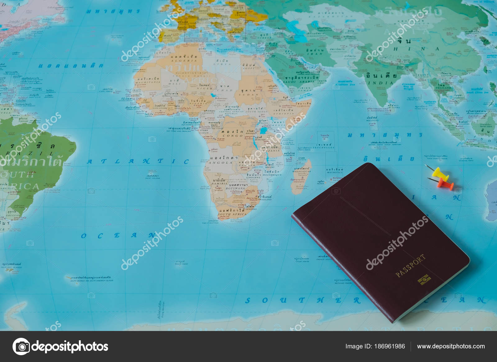 Top view color world map with small pin and passport placed on top view color world map with small pin and passport book placed on them this image for international travel equipment country concept photo by gumiabroncs Image collections