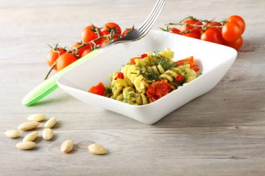 Pasta with fennel pesto, almonds and cherry tomatoes
