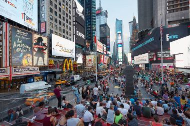 Times Square view with people from tkts bleacher seats in New York