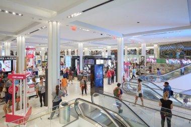 Macy's department store interior, cosmetics area with escalators in New York