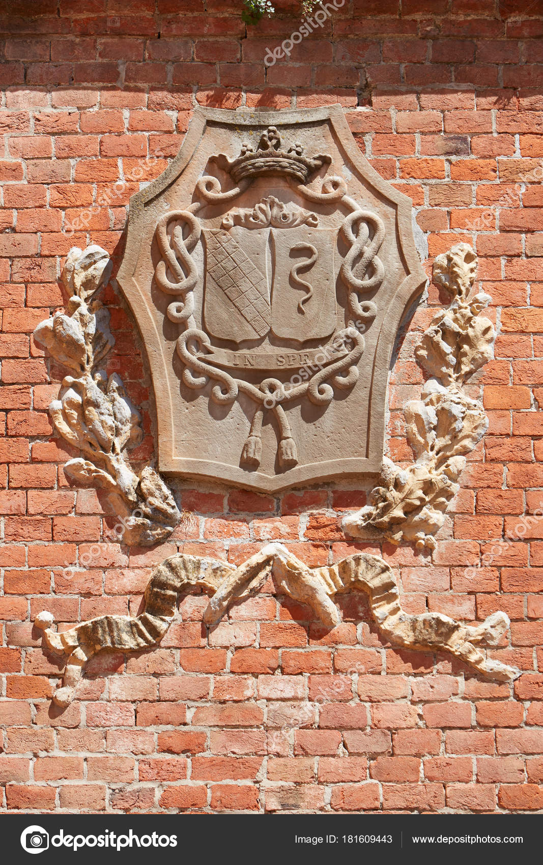 barolo italy august 6 barolo medieval castle coat of arms on red bricks wall in a sunny summer day on august 6 2016 in barolo italy