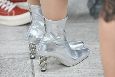 Woman with silver, metallic high heel shoes before Emporio Armani fashion show, Milan Fashion Week street style