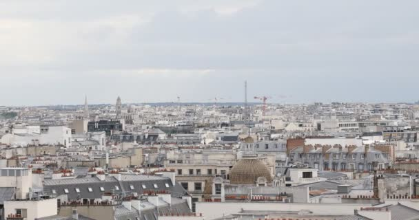 Paris rooftops view and Eiffel Tower, pan view in a cloudy day in France
