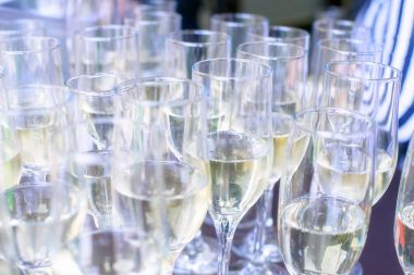 Close-up iced champagne or sparkling wine in glass flutes on a table in a restaurant ready for an extravaganza, celebration or a party