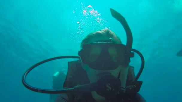 Woman diving in Utila closeup selfie