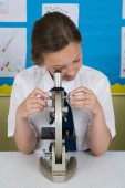 Girl looking in microscope