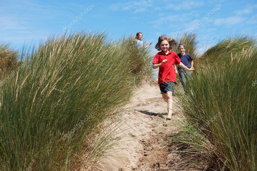Children running through Sand Dunes