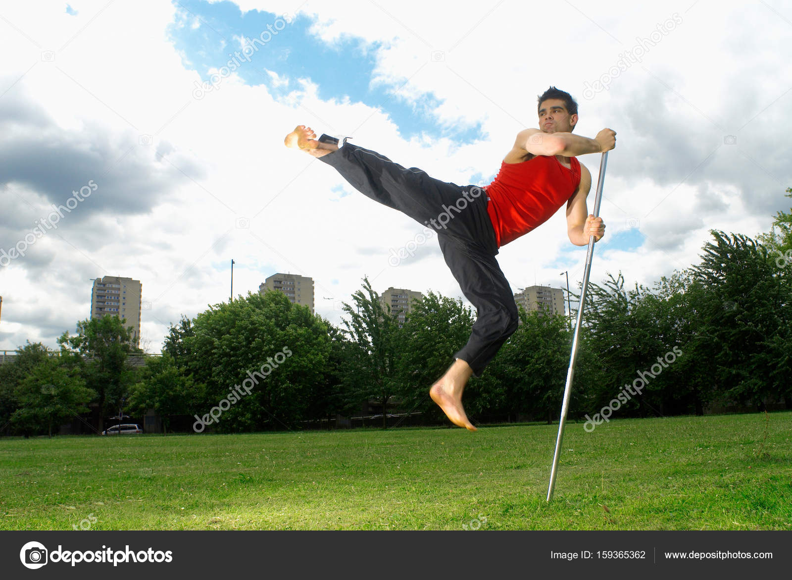 Man jumping using bow staff — Stock Photo © ImageSource #159365362