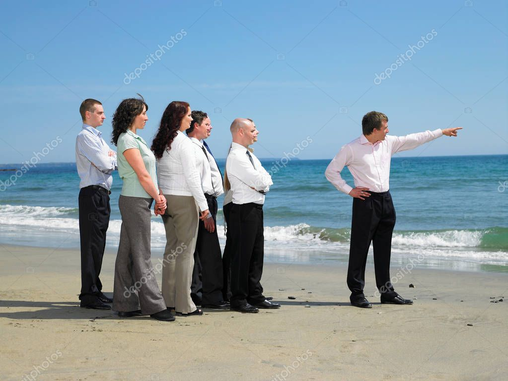 Group of business people on the beach.
