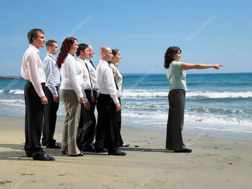 Group of businesspeople on the beach.